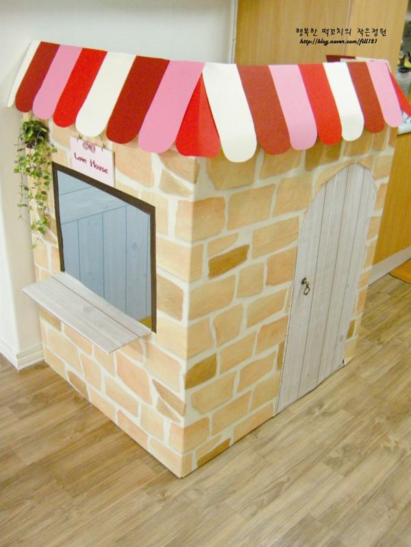 casa de papelao tijolos